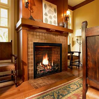 large indoor fireplace with firelogs