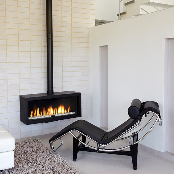 small modern fireplace with stovepipe