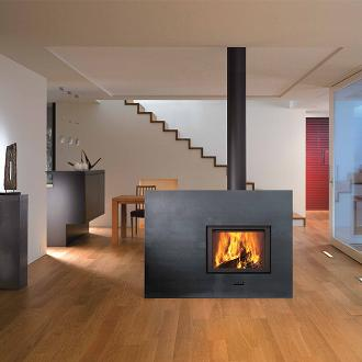 large indoor fireplace feature with stovepipe
