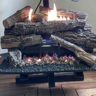 stack of fake logs on hearth